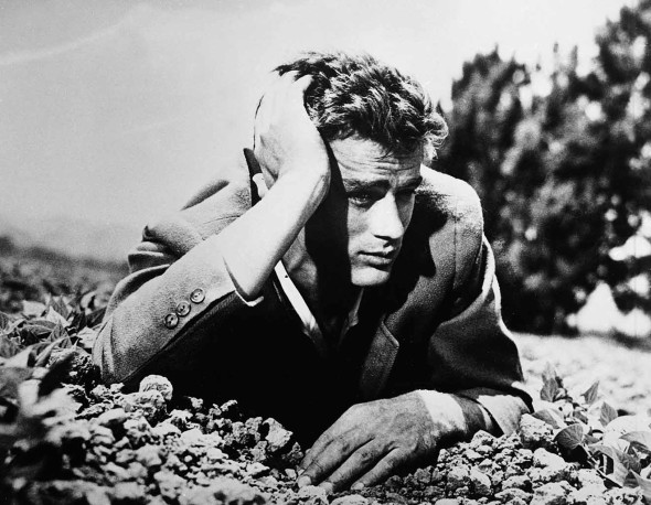 American actor James Dean (1931 - 1955) lies in the dirt with his head leaning on his hand, 1950s. (Photo by Hulton Archive/Getty Images)